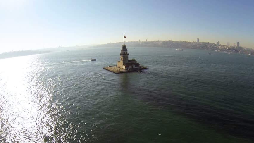 Maidens Tower, Aerial. Flying over Bosphorus Sea towards historical lighthouse. High angle view at Istanbul, Turkey. 