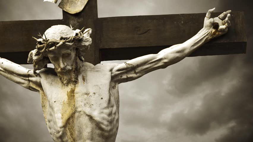 Jesus Christ crucified. The Crucifixion. Christian cross with Jesus Christ statue over stormy clouds time lapse. 1920x1080, 1080p, hd format. - HD stock footage clip