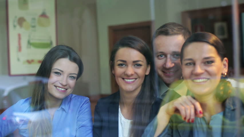 Businesspeople smiling to camera and sit in cafe behind window, steadycam shot.  | Shutterstock HD Video #6193640