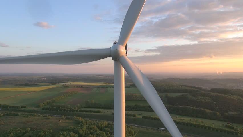 Wind turbines producing clean renewable energy - HD stock video clip