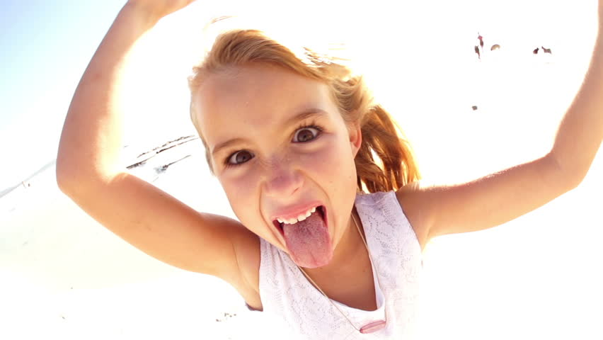 Young girl sticking longtongue out