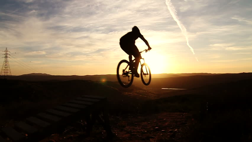 Slow Motion Silhouette Mountain Biking Off Extreme Jump