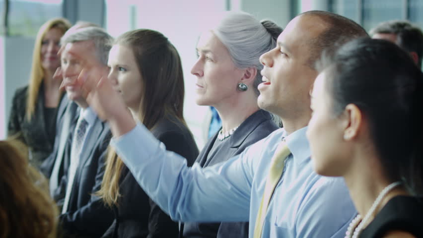 Cheerful diverse business team attend business presentation or training seminar - HD stock footage clip