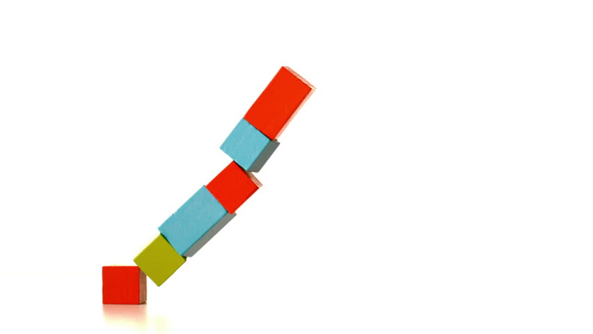 Building Falling Over : Tower of building blocks falling over in slow motion stock