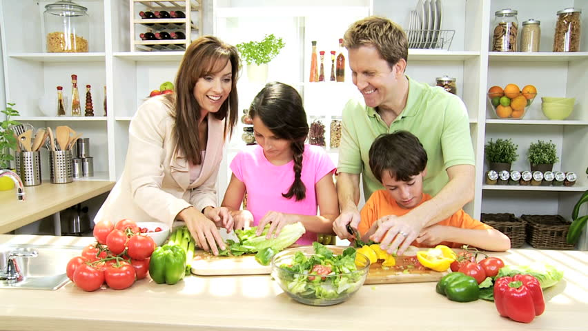 Caucasian family preparing organic salad dinner for How to cook a good meal for dinner