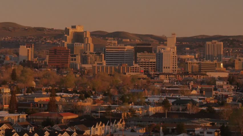 Reno, Nevada - March, 2014 - Close up of the sun rising over downtown Reno.