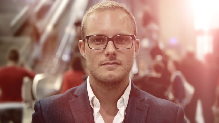 Businessman facing camera. young caucasian man. male wearing glasses. handsome blond guy. business professional background. crowd people. busy hectic. person standing. handsome men | Shutterstock HD Video #6356189