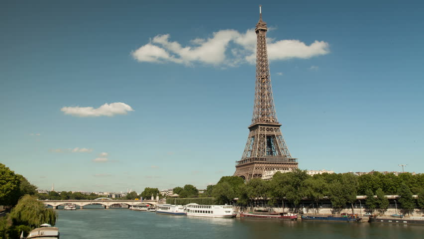 Timelapse of the impressive Eiffel tower in Paris by the famous river 'La Seine'. Boats with tourists and goods are passing by.  | Shutterstock HD Video #6357377