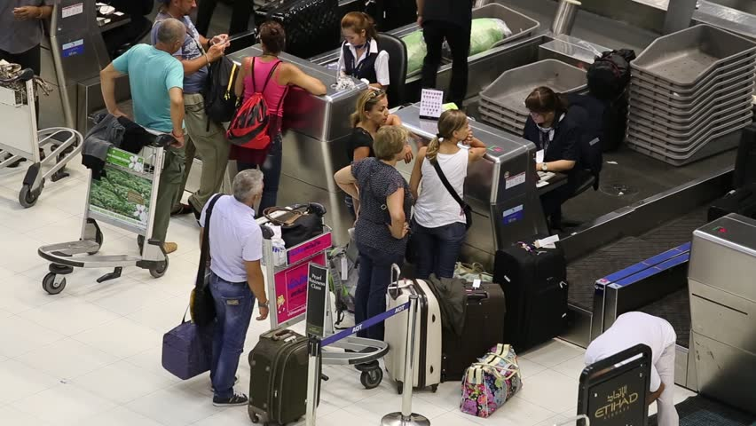 BANGKOK, THAILAND - APRIL 27, 2014 : Unidentified passengers arrive at check-in counters at Suvarnabhumi Airport . The airport handles 45 million passengers annually.  - HD stock footage clip
