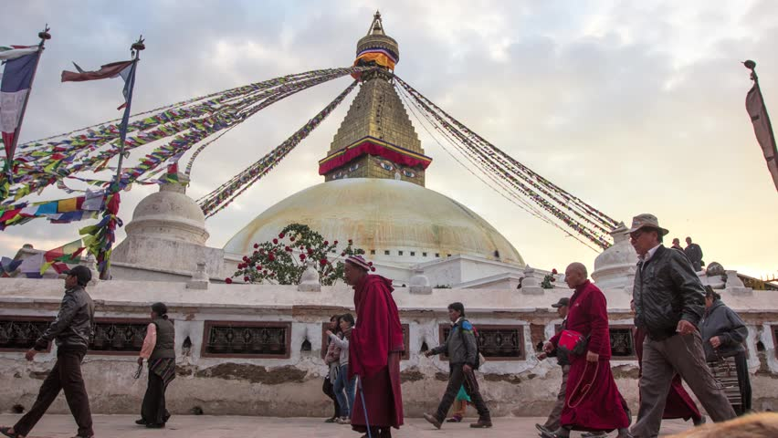 KATHMANDU, NEPAL - DEC 2, 2013: Timelapse: Unidentified pilgrims circle stupa Boudhanath on evening time. Stupa is one of the largest in the world, of 1979 is a UNESCO World Heritage Site. (HD/25 fps) - HD stock video clip