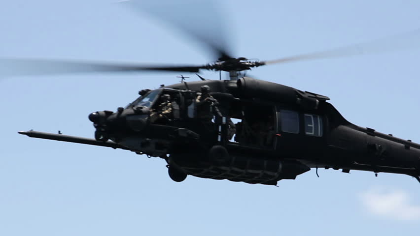 Military helicopter flying close.