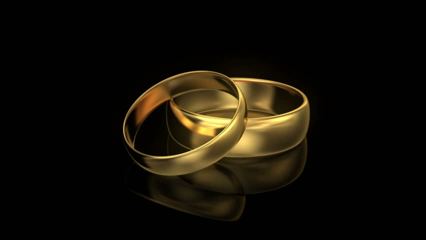 two wedding rings on black background 3d stock footage