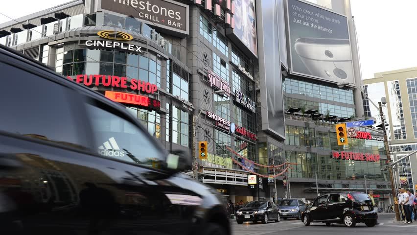 TORONTO,CANADA-MAY 24,2014: Intersection in Yonge St. and Dundas St. where Dundas Square is. The intersection is one of the busiest in Canada, serving over 100,000 pedestrians daily