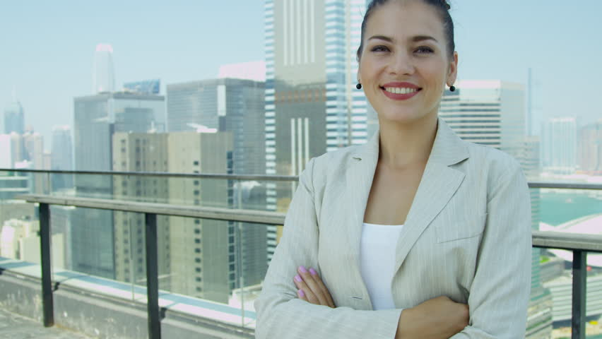 Successful young Asian Chinese businesswoman rooftop modern office skyscraper building smiling camera head shoulders portrait shot on RED EPIC   Shutterstock HD Video #6435182