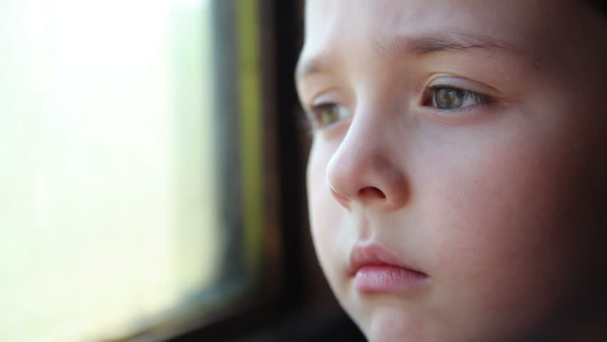 small child is traveling in a train and looks window 3 - HD stock video clip