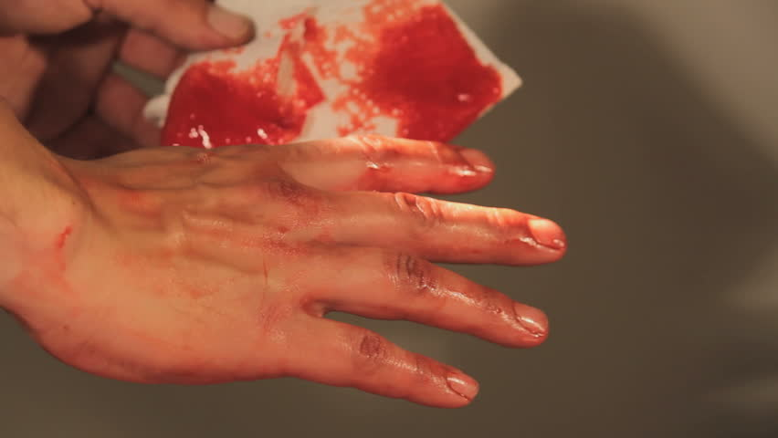 Cleaning a Bloody Hand with toilet paper
