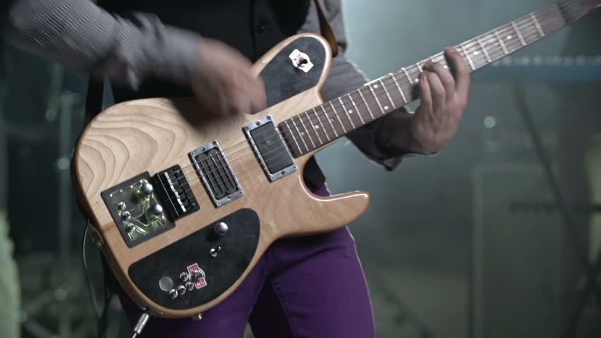 Close up of electric guitar played by unrecognizable musician at concert - HD stock video clip