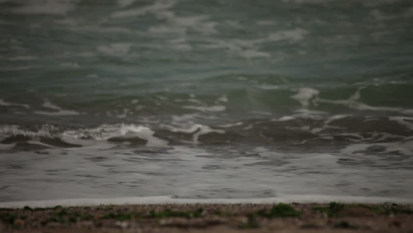 Ocean waves washing beach sands. - HD stock footage clip