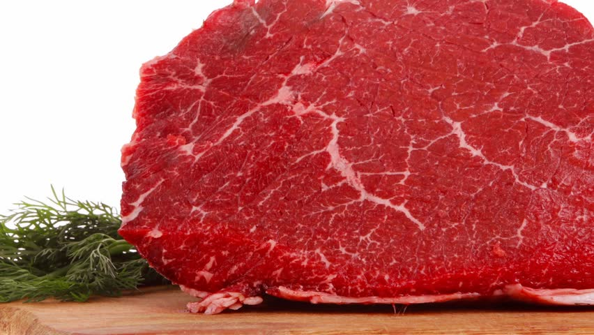 fresh raw red beef meat big steak chunk on wooden cut board 1920x1080 intro motion slow hidef hd