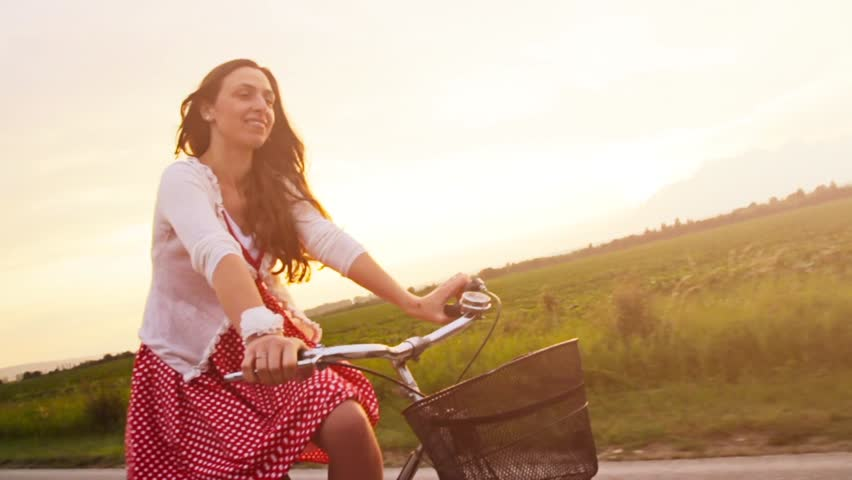 Happy Young Woman Smiling Laughing Riding Bicycle Slow Motion