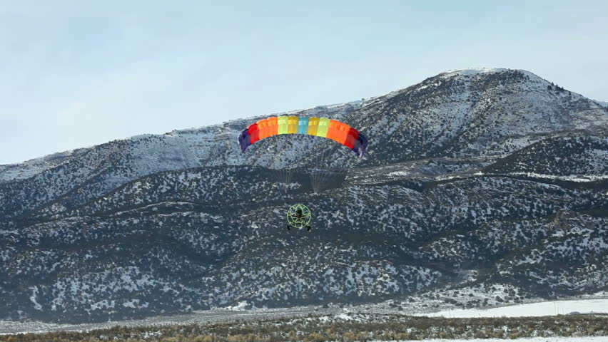 MORONI, UT- CIRCA JAN 2010: Mike Jacobson of Moroni flies in Powered parachute circa Jan 2010 in Moroni, Utah, USA. Powered parachute lands on ice covered lake.  Central Utah winter recreation sport. - HD stock footage clip