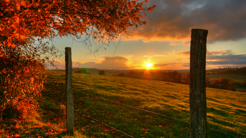 Autumn sunset over fields through barrier, hd motion control time lapse clip, high dynamic range imaging