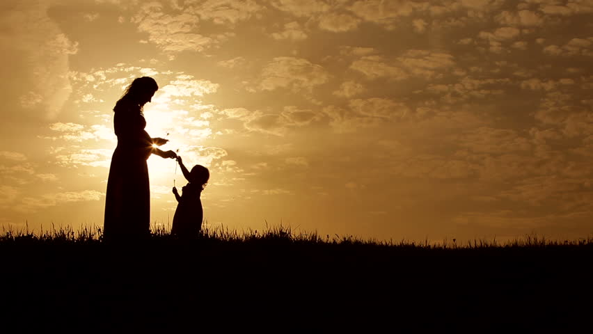 Silhouettes young mother and  her 3 year old daughter at sunset | Shutterstock HD Video #6584186