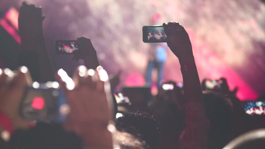 People taking photos or recording video with their smart phones at music concert - HD stock video clip