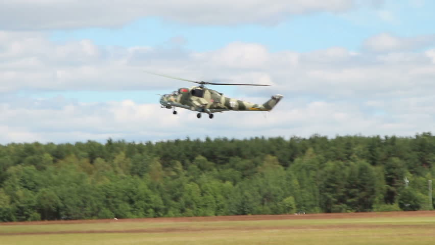Airshow, Belarus, Minsk - 21.06.2014: Airshow, devoted to the 80th anniversary of DOSAAF. performance of MI-24 helicopters