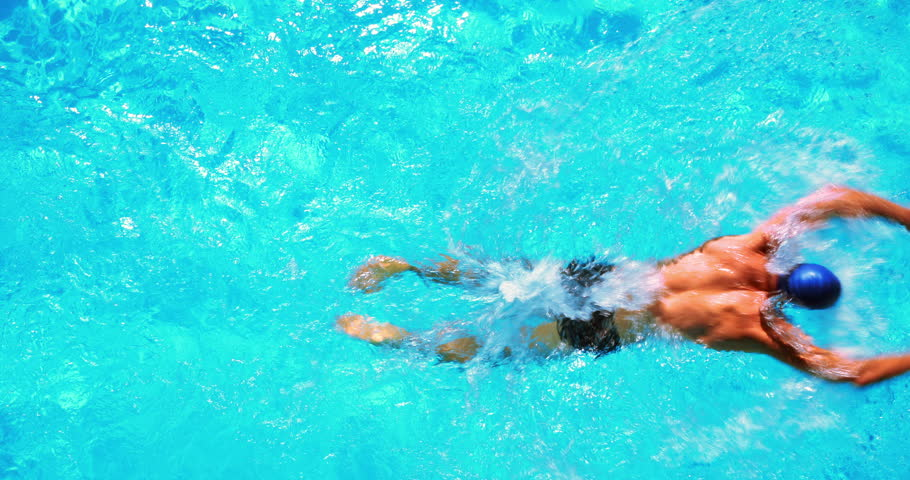 Fit swimmer in the swimming pool on a sunny day - 4K stock footage clip