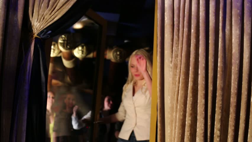 Twenty-two happy young men and women go out door of night club - HD stock footage clip