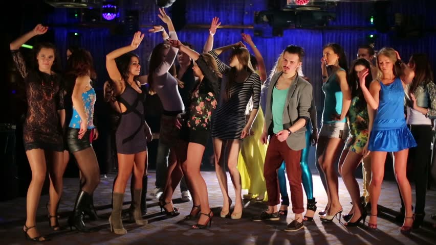 Eighteen happy young people dance and have fun at night club - HD stock footage clip
