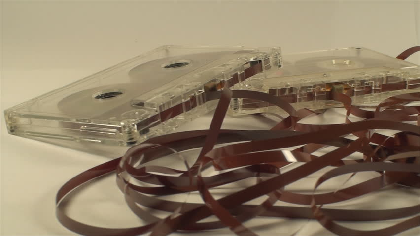 Broken Audio Cassettes Isolated On White, Loose Tape, Retro, Close Up Pan Shot