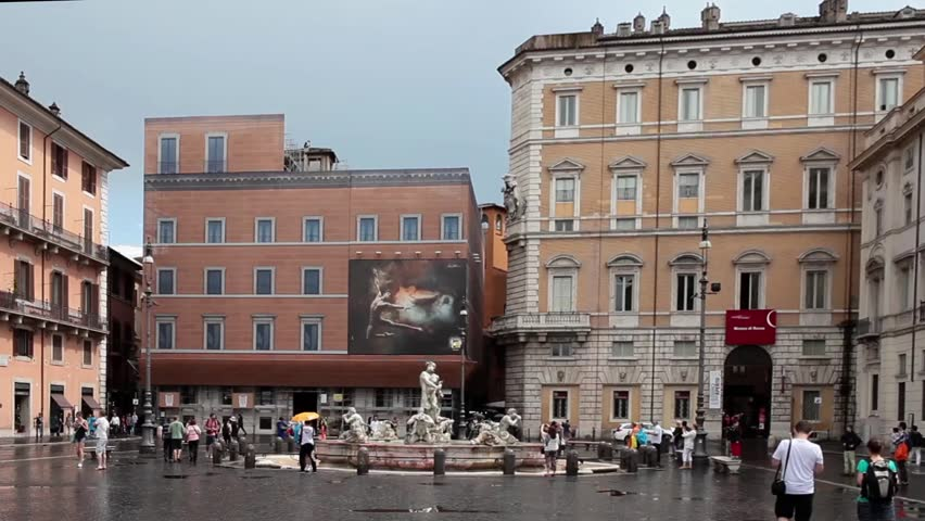 ROME, ITALY - JUNE 18, 2014: Navona square during the bad weather which has hit Rome for the fourth consecutive day. In the background Palazzo Lancellotti, Palazzo Braschi and The Moor Fountain.