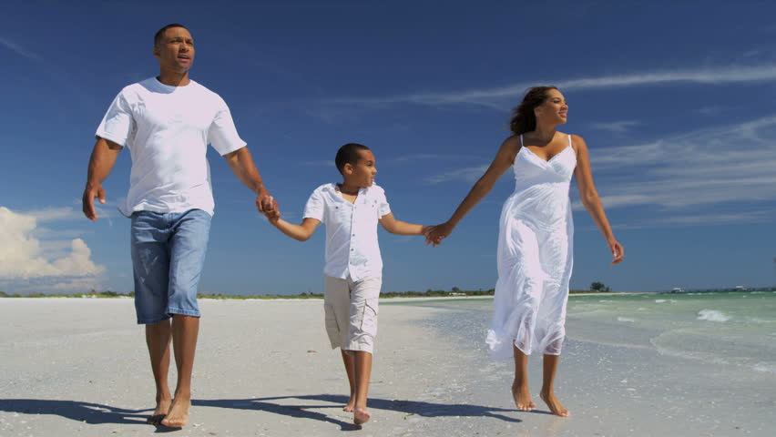Young Ethnic Parents Son Beach Vacation - Loving African American parents young son spending time together walking along beach ocean shallows slow motion shot on RED EPIC | Shutterstock HD Video #6685814