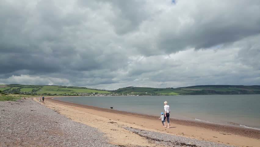 FORTROSE, HIGHLANDS/UK - MAY 14, 2014: Unidentified people walk on the beach at Chanonry Point on the Moray Firth near Inverness, Scotland. Visitors come here to see the bottle nose dolphins.