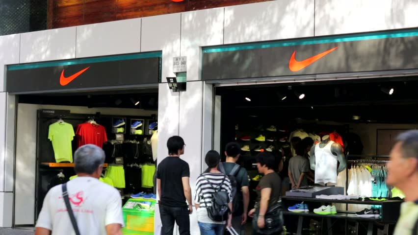 HONG KONG, CHINA - CIRCA JUNE 2014: People visit Nike store. Nike is one of most recognized fashion brands. It exists since 1964 and had US$ 19 billion revenue (2010).