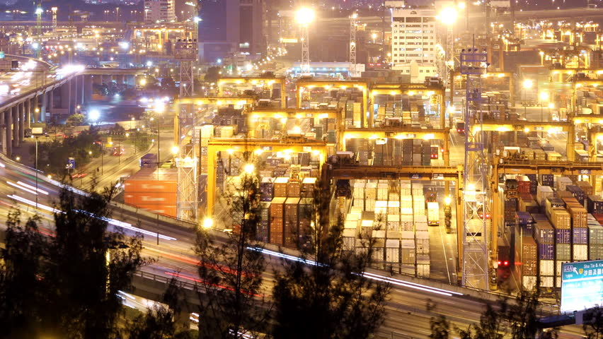 Busy City Night Timelapse. Pan shot from cargo container terminal at the right to busy traffic highway at the left. - HD stock video clip