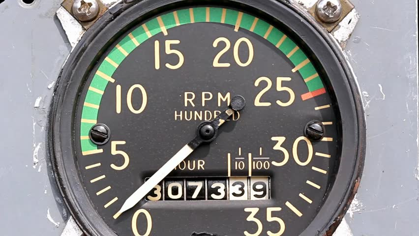 Mechanical Tachometer With Hour Meter Gauge : Mechanical aircraft tachometer and hour meter on a gray