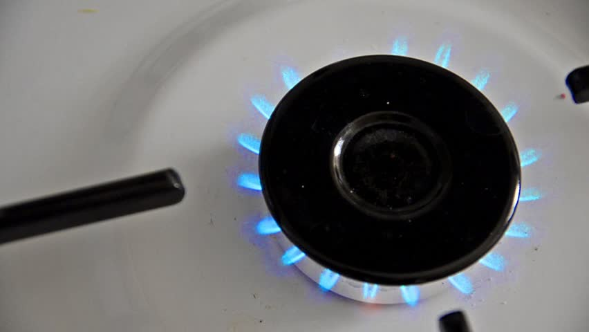Natural gas inflammation in stove burner, close up top view LOOP - HD stock video clip