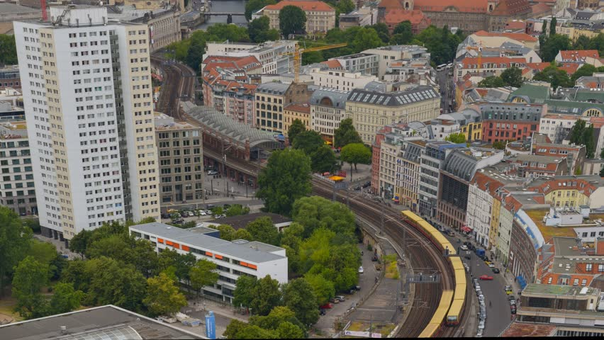 A 4k UHD time lapse  tilt, pan and zoom in berlin shows traffic, aerial view. 11427
