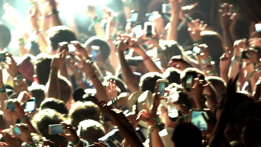 Crowd at Concert - Fans Cheering in Audience with Smartphones in Music Show at Coachella in Slow Motion