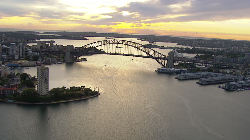 Wide aerial shot of the Sydney Harbour Bridge from west to east / south WITH Circular Quay, Botanic Gardens, CBD,  Milson's Point, Luna Park, Walsh Bay, Farm Cove & Potts Point
