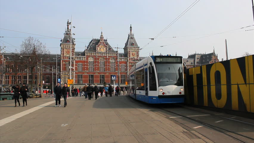 AMSTERDAM, NETHERLANDS - APRIL 9: Tram, ciclysts and buses along Amsterdam Station area, Amsterdam, on 9 April 2013.