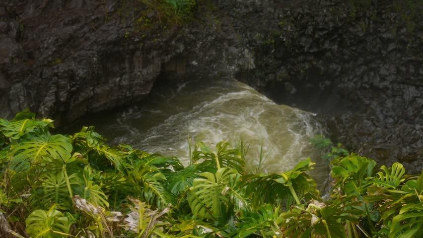 Hilo, Hawaii - May, 2014 - Medium panning shot of Peepee Falls and Boiling Pots.