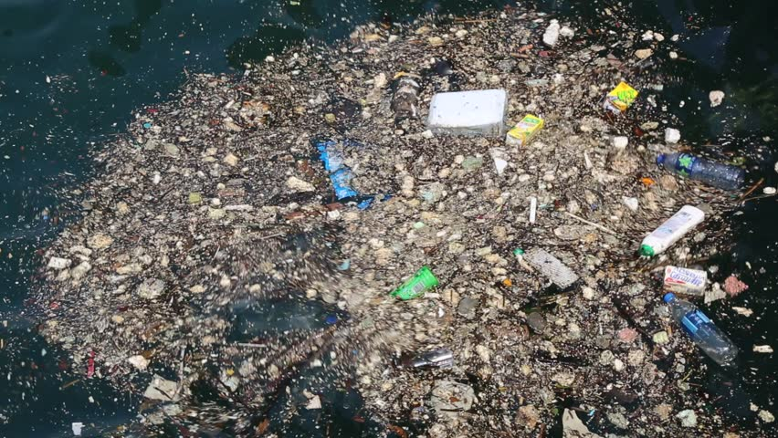 Rubbish and Pollution Floating in Water - HD stock video clip