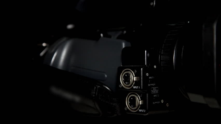 HD Video Camera In Black. Shallow focus and light reflection on the lens. - HD stock footage clip