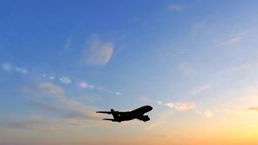 Airplane Take Off Silhouette in the sunset