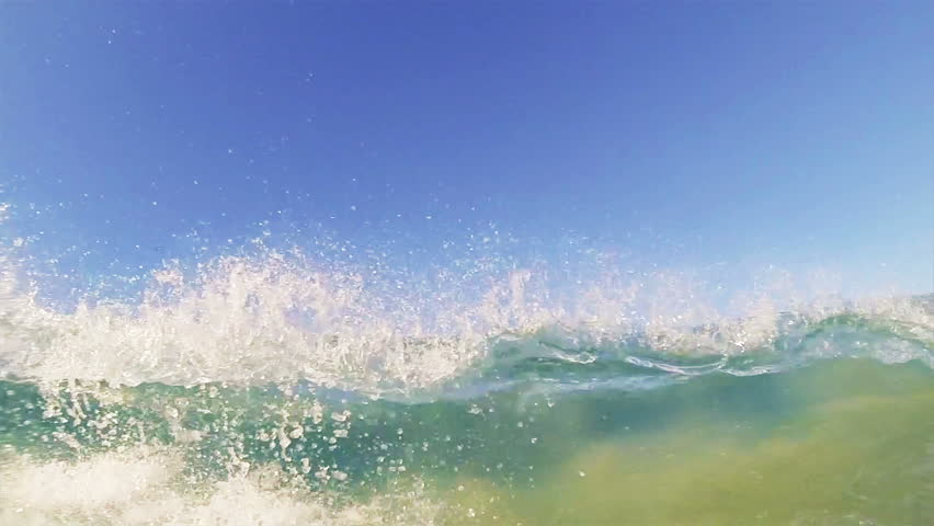 Blue Ocean Wave Crashing in Slow Motion