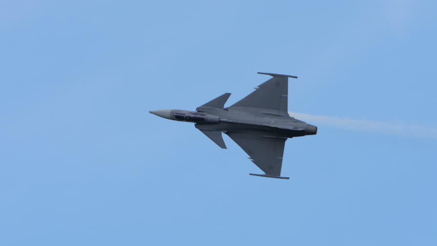 SKAVSTA, SWEDEN - AUG 31: JAS 39 Gripen, a Swedish jet fighter plane in an airshow, August 31, 2014 at Skavsta, Sweden, 4k.